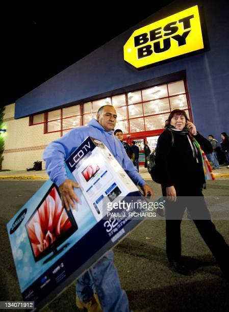 An unidentified man carries out his new 32inch LCD TV he just purchased on Black Friday at the Fair Lakes Best Buy store November 23 2011 in Fairfax...