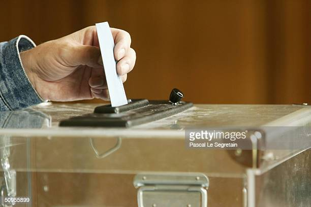 An unidentified man casts his vote for the European Parliament Elections on June 13 2004 in Paris France