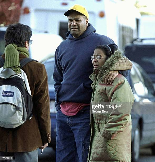 An unidentified man comforts Marina DeLaCruz as she arrives at the Ramada Inn in Queens New York shortly after learning that her mother and sister...