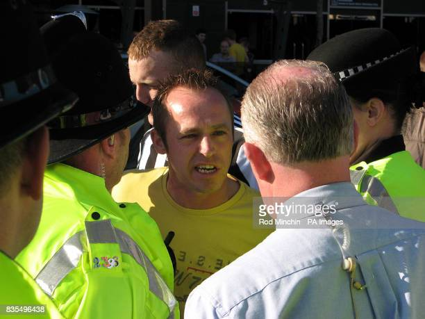 An unidentified man directs his anger towards Sky Sports reporter David Craig outside St James' Parkafter Newcastle was relegated from the Premier...