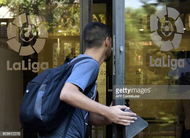 An unidentified man enters the Spanish Professional Football League La Liga headquarters in Madrid on August 3 2017 Spain's La Liga refused to accept...