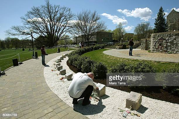 An unidentified man grieves at a memorial of 32 granite blocks representing each of the people killed by Cho SeungHui at Virginia Tech April 15 2008...