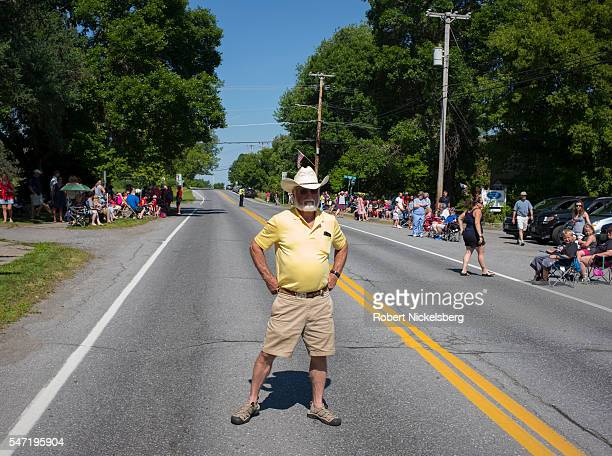 An unidentified man hands on his hips stands on Williston Road as he waits for the annual Fourth of July Independence Day parade Williston Vermont...