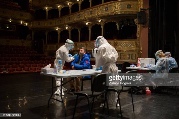 An unidentified man is administrated Covid-19 antigen test in the State Theatre Kosice during a massive testing of the Slovak population on January...