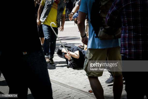 An unidentified man is attacked by the Rose City Antifa at Pioneer Courthouse Square on June 29 2019 in Portland Oregon Several groups from the left...