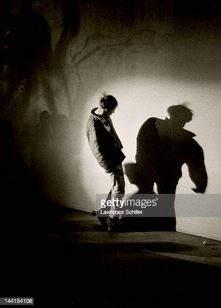 An unidentified man looks at his shadow during an LSD trip at an 'Acid Test' party on Sunset Blvd Los Angeles California 1966 The man took the acid...