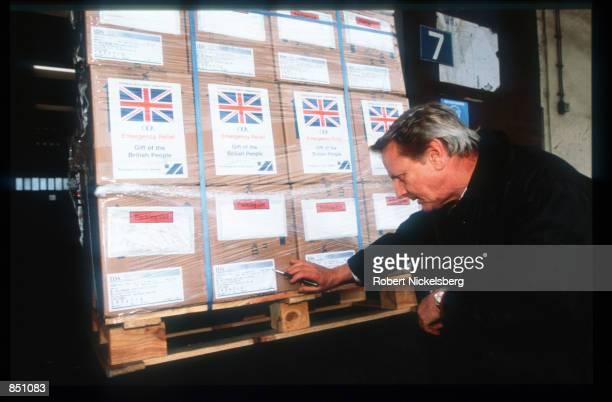 An unidentified man looks at packages at the Batnaga refugee camp December 11 1994 in Batnaga BosniaHerzegovina Civil war erupted in Bosnia and...