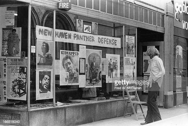 An unidentified man looks in the window of the Black Panther Party headquarters New Haven Connecticut May 1970