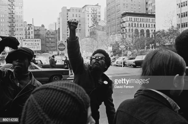 An unidentified man raises his fist in defiance at a protests against the incarceration of members of the Black Panthers, New York, New York,...