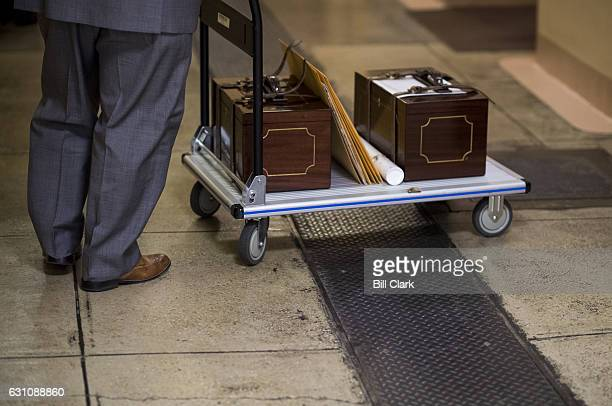 An unidentified man rolls the Electoral College ballot boxes onto an elevator to move them from the basement of the US Capitol up to the US Senate...
