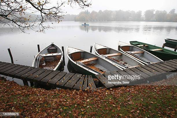 An unidentified man rows in the Wessling lake on a foggy autumn day on October 31 2011 in Wessling Germany