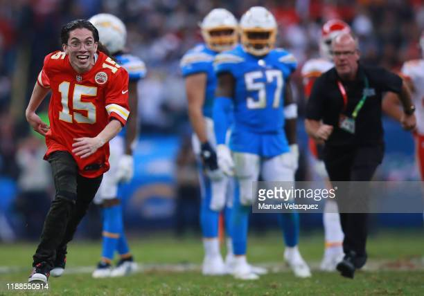 An unidentified man runs on to the field during the game between the Kansas City Chiefs and the Los Angeles Chargers at Estadio Azteca on November 18...