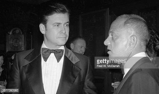 An unidentified man speaks with American attorney Roy Cohn at Cohn's birthday party at the Seventh Regiment Armory , New York, New York, February 22,...