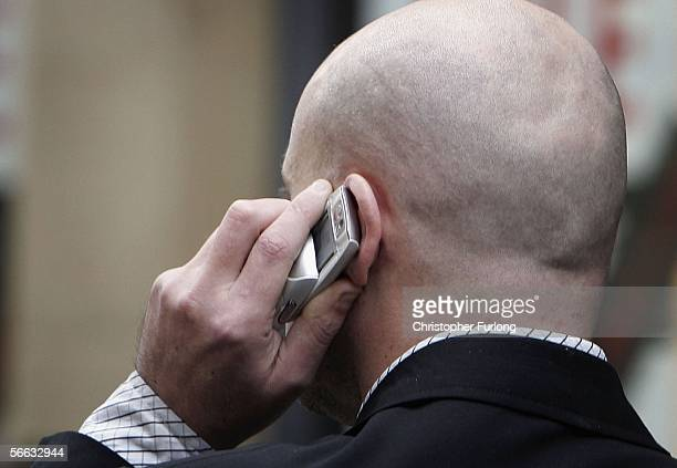 An unidentified man uses his mobile telephone without ear piece on January 20 2006 in Manchester England A longterm study has found that there is no...