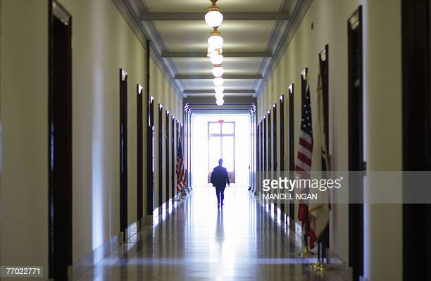 An unidentified man walks down a hallway of the Russell Senate Office Building 25 September 2007 on Capitol Hill in Washington, DC. AFP PHOTO/Mandel...