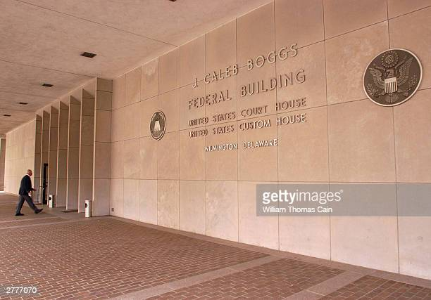 An unidentified man walks into the J Caleb Boggs Federal Building during a break in a trial brought against DaimlerChrysler AG by Kirk Kerkorian...