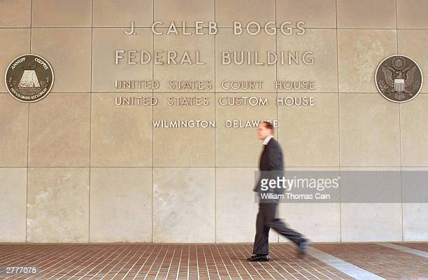 An unidentified man walks outside the J Caleb Boggs Federal Building during a break in a trial brought against DaimlerChrysler AG by Kirk Kerkorian...