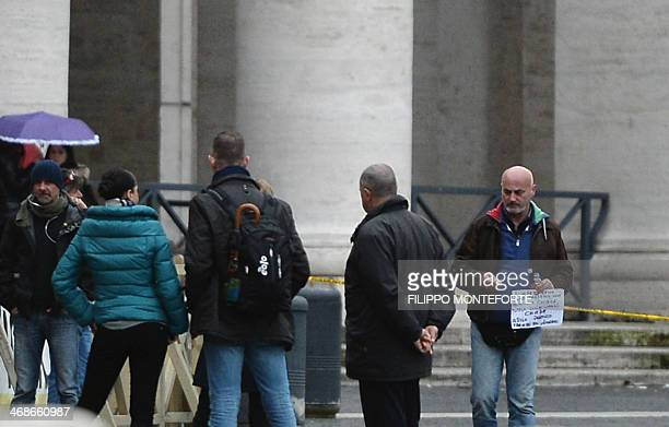 An unidentified man wearing an italian flag and carrying a bottle of gasoline threatens to set himself alight on February 11 in Saint Peter square at...