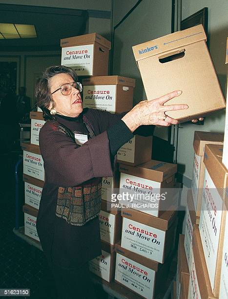 An unidentified member of an organization called Censure and Move On stacks boxes of letters and petitions at the US Capitol 16 December that are...