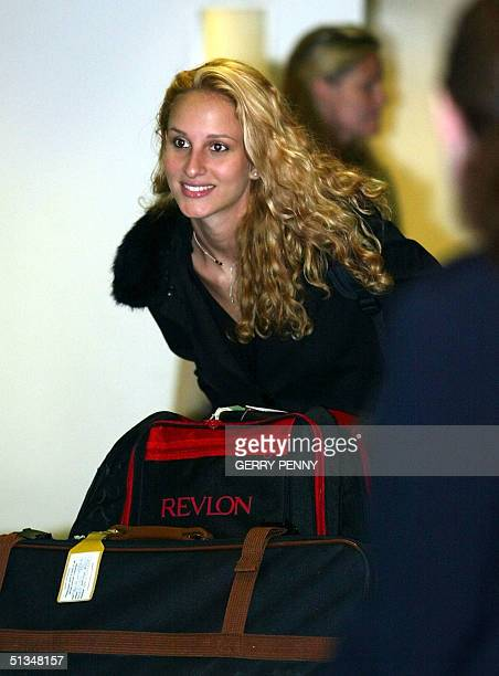 An unidentified miss World contestant smiles at the crowd upon her arrival at Gatwick Airport 24 November 2002. Miss World contestants arrived in...