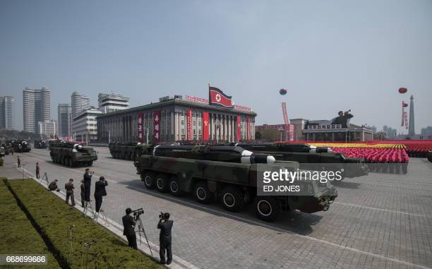 An unidentified missile and mobile launcher makes its way through Kim IlSung square during a military parade marking the 105th anniversary of the...
