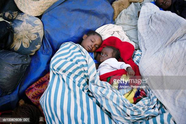 An unidentified mother and her children sleep on a boat with destination Kinshasa on April 1 2006 in Bokondo Congo DRC Passengers sleep in the open...