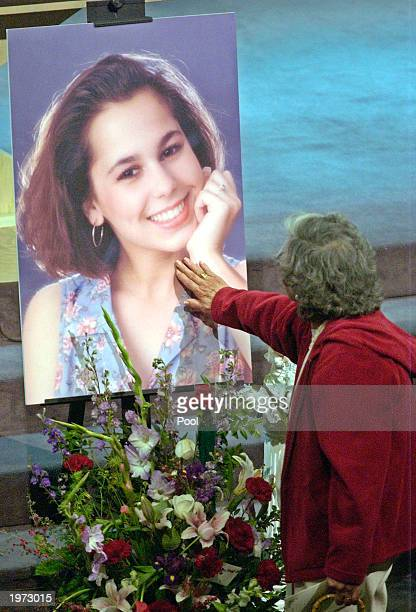 An unidentified mourner touches a picture of Laci Peterson during the memorial service for Laci Peterson and her unborn son Conner May 4 2003 in...