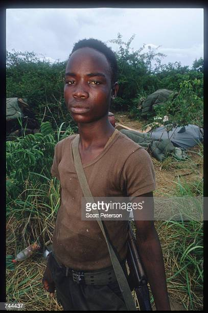 An unidentified MPLA soldier stands March 13 1993 near a beach in Soyo Angola State radio claims that government troops recaptured the oil town of...