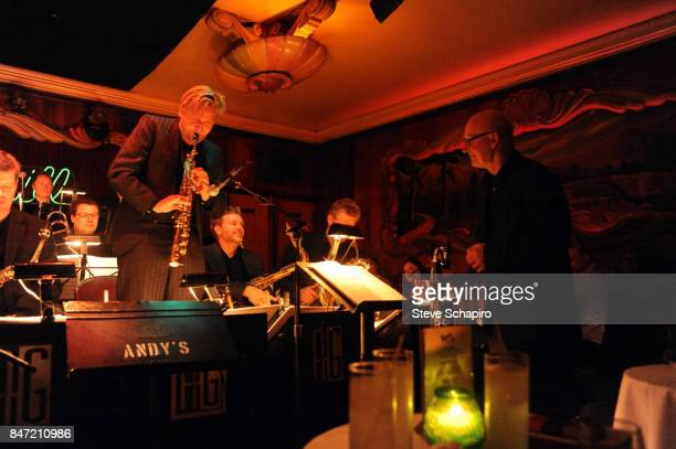 An unidentified musician from the Kluvers Big Band performs a solo as Danish bandleader and conductor Jens Kluver listens onstage at the Green Mill...