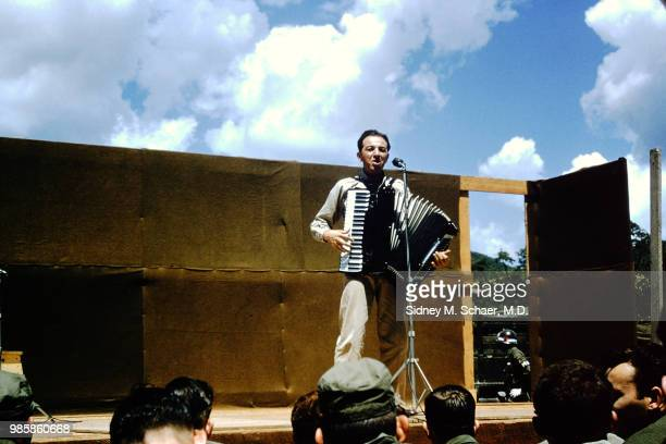 An unidentified musician plays accordion as he performs onstage at the 8063rd MASH South Korea January 1952