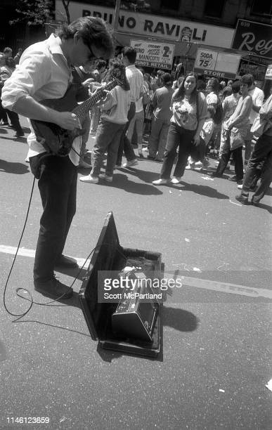 An unidentified musician plays guitar on 9th Avenue in Hell's Kitchen during the International Food Festival New York New York May 14 1988