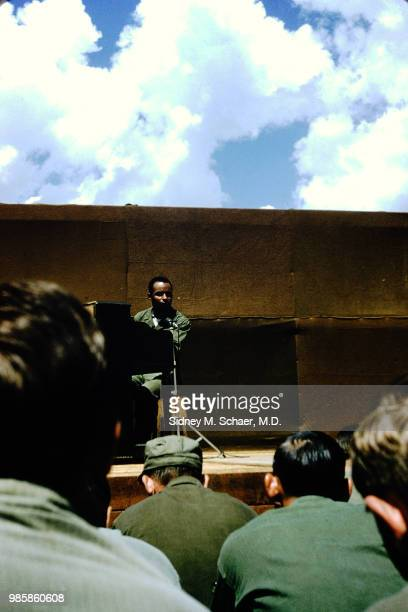 An unidentified musician plays piano as he performs onstage for troops at the 8063rd MASH South Korea January 1952