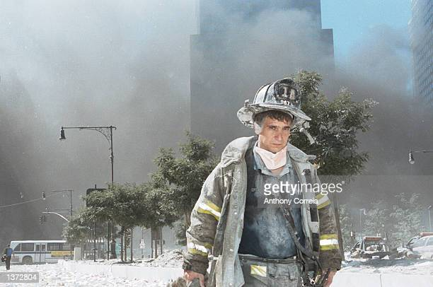 An unidentified New York City firefighter walks away from Ground Zero after the collapse of the Twin Towers September 11 2001 in New York City The...
