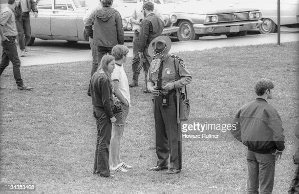 An unidentified Ohio State Highway Patrol officer speaks with Kent State University students in the wake of the Ohio National Guard's shooting of...