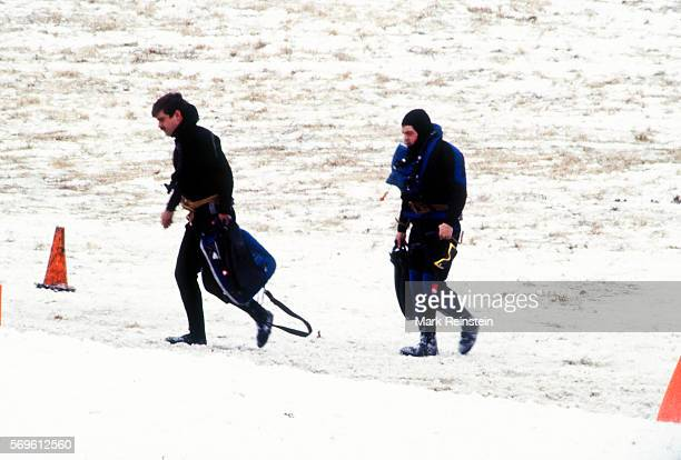An unidentified pair of US Navy divers walk through the snow during the salvage of Air Florida Flight 90 Washington DC January 16 1982 On January 13...