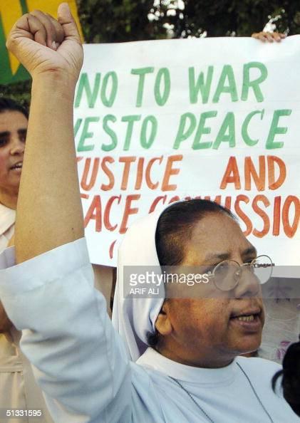 An unidentified Pakistani Roman Cahtolic nun chants anti-war