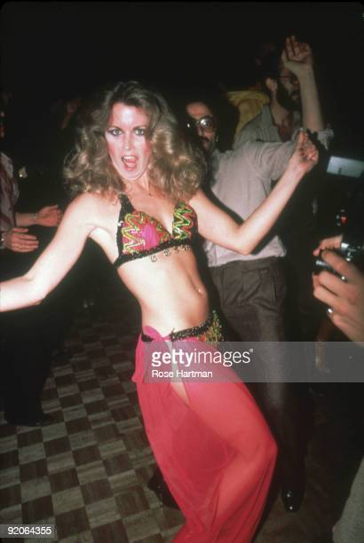 An unidentified partygoer dances in a bikini and transparent skirt at the nightclub Studio 54 New York New York late 1970s or early 1980s