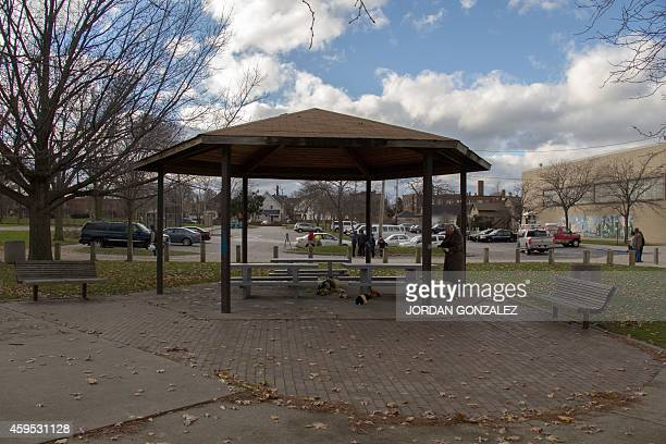 An unidentified person at Cudell Commons Park in Cleveland Ohio November 24 2014 stands under a gazebo where a memorial was set up for Tamir Rice a...