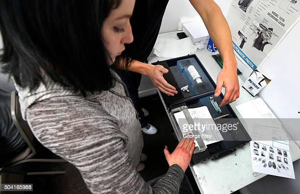 An unidentified person has her fingerprints taken as part of a Utah concealed gun carry permit class at Range Master of Utah on January 9 2016 in...