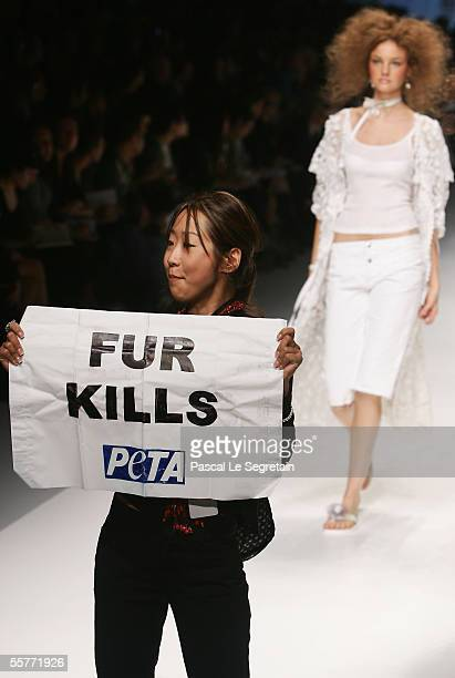 An unidentified PETA activist holds a banner reading 'Fur Kills' during the DG's Spring/Summer 2006 women's collection at Milan's fashion week on...