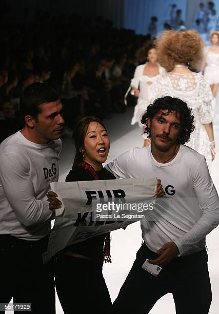 """An unidentified PETA activist holds a banner reading """"Fur Kills"""" during the D&G's Spring/Summer 2006 women's collection at Milan's fashion week on..."""