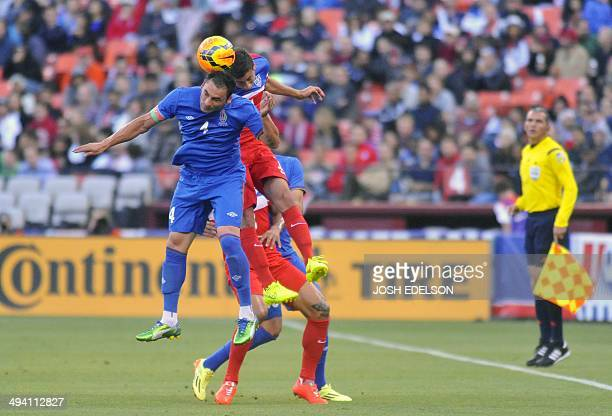 An unidentified player from the US men's national team collides with Mahir Shukurov of Azerbaijan during their World Cup preparation match at...