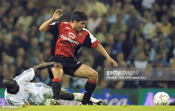 An unidentified player of Real Valladolid is tackled by Makelele of Real Madrid during the match opposing Real Madrid and Real Valladolid in Madrid...