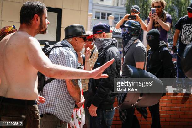 An unidentified right aligning man faces off with Rose City Antifa members at Pioneer Courthouse Square on June 29 2019 in Portland Oregon Several...