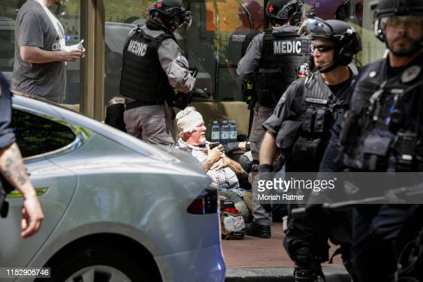 An unidentified right aligning man receives medical assistance after being brutally attacked by the Rose City Antifa at Pioneer Courthouse Square on...