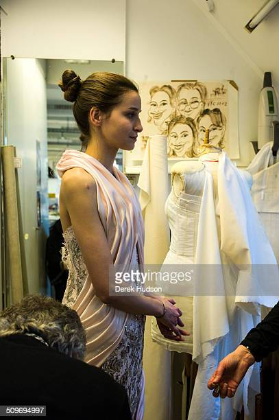An unidentified seamstress in the Chanel atelier works on one of Karl Lagerfeld''s designs for his fashion show Paris France 2010