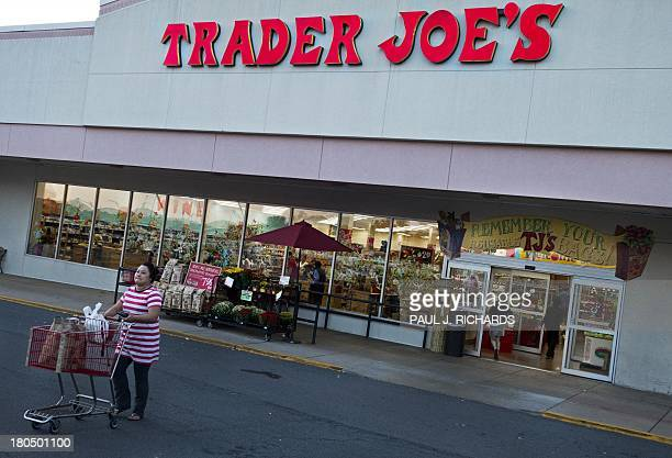 An unidentified shopper leaves with her groceries from Trader Joe's in Centreville Virginia on September 13 2013 The national supermarket chain...