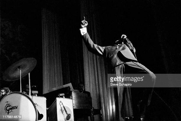 An unidentified singer performs on stage at the Apollo Theater, New York, New York, 1961.