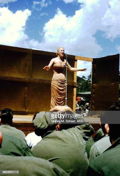 An unidentified singer performs onstage at the 8063rd MASH South Korea August 1952
