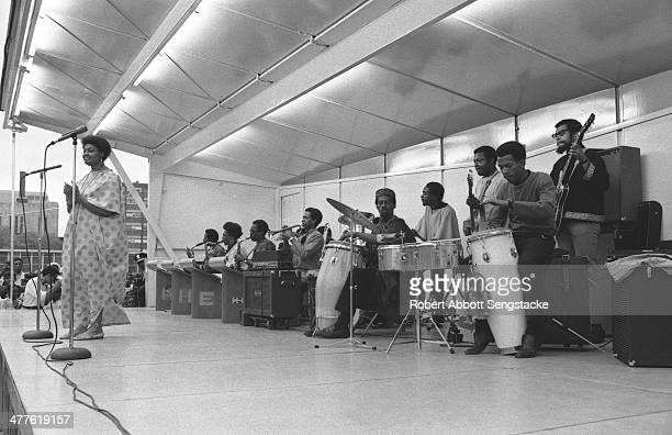 An unidentified singer performs with Phil Cohran and the Artistic Heritage Ensemble at Cabrini Green, Chicago, Illinois, 1968 or 1969.